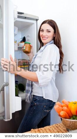 woman looking something at fridge stock photo © nobilior