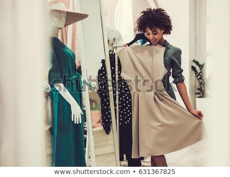 morena · preto · vestir · posando · sofá · menina - foto stock © hasloo