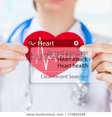 Doctor holding heart and heartbeat symbol with search engine and Stock photo © hasloo