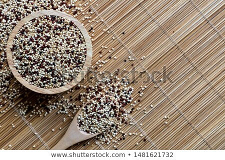 uncooked quinoa in the wooden spoon Stock photo © marimorena