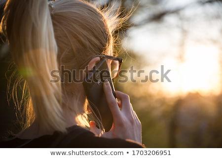 Backlit woman Stock photo © Tawng