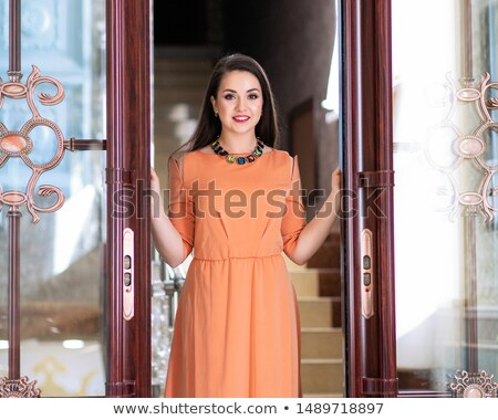 Gorgeous Shapely Woman in Long Smooth White Dress Stock photo © gromovataya