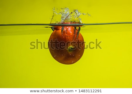 tomatoes thrown in water Stock photo © mady70