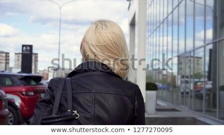 Belo jovem loiro mulher ao ar livre edifício moderno Foto stock © Nejron