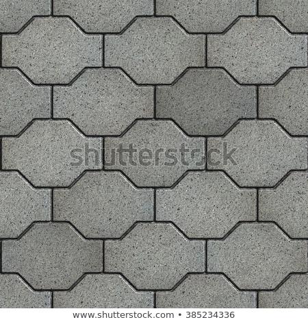 gray wavy paving slabs stock photo © tashatuvango