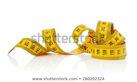 Amarelo plástico fita métrica em pé branco construção Foto stock © dezign56