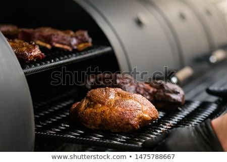 Meat in the smoker Stock photo © elvinstar