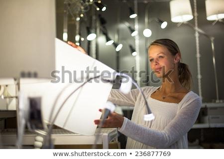 Bastante mulher jovem escolher direito luz apartamento Foto stock © lightpoet