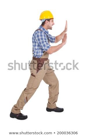 Happy Manual Worker Pushing Billboard Stock photo © AndreyPopov