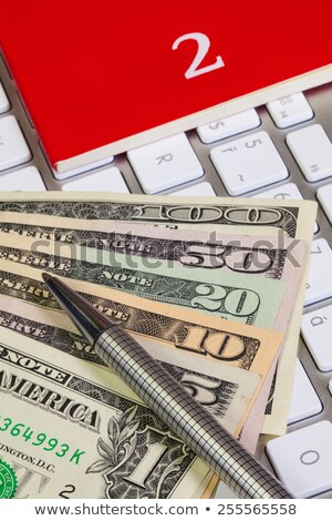 Business desk - Diary for February,US dollars,pen and keyboard Stock photo © CaptureLight