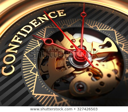 Self Confidence on Black-Golden Watch Face. Stock photo © tashatuvango