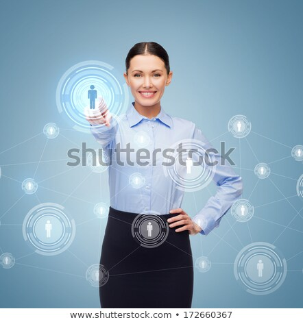 Businesswoman pointing at you with colleagues in office Stock photo © wavebreak_media