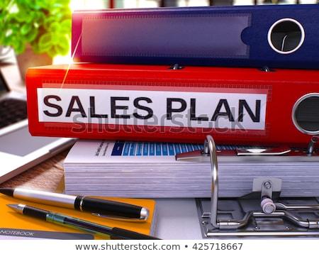 red ring binder with inscription sales plans stock photo © tashatuvango