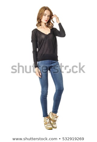 attractive young girl in jeans studio shot stock photo © neonshot