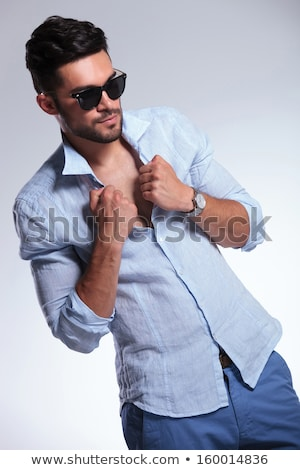 young casual man unbuttoning his jeans shirt Stock photo © feedough