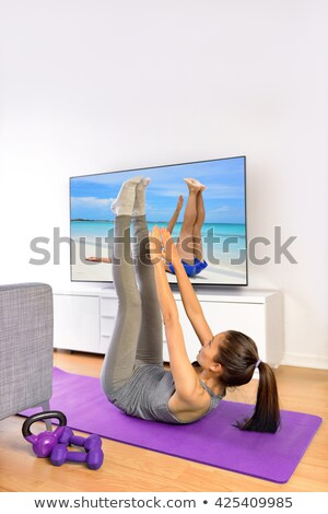 Abs exercise fitness woman - toe touch crunches Stock photo © Maridav