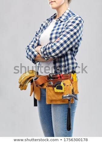Woman with a tool belt. Stock photo © Kurhan