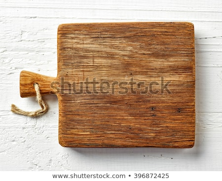 old rustic wooden kitchen board on a white background stock photo © zerbor