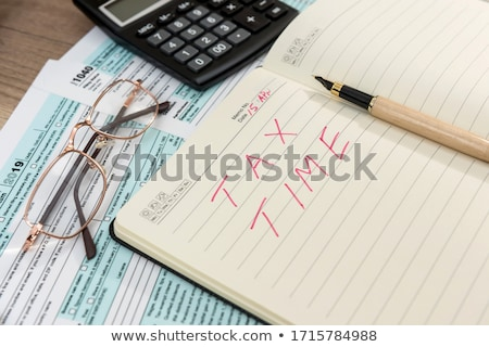 Taxes text on notepad Stock photo © fuzzbones0
