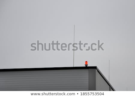 an airplane near the tall buildings stock photo © bluering