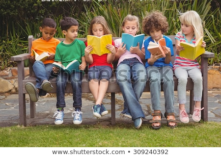 A boy reading while sitting down Stock photo © bluering