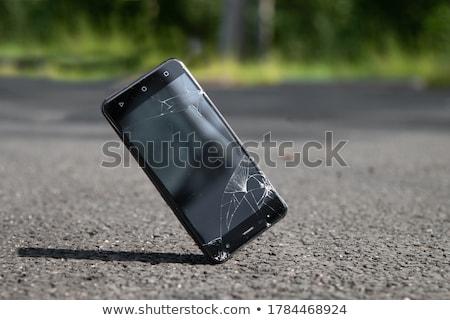 Broken smart phones Stock photo © coprid