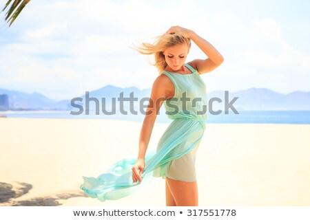 sad blonde in turquoise dress Stock photo © ssuaphoto
