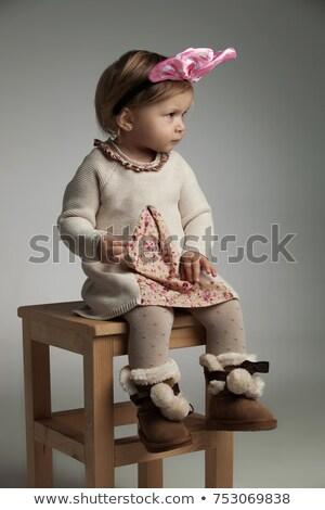 seated little girl wearing headband looks away stock photo © feedough