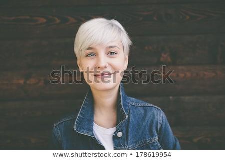 sorridente · mulher · jovem · jeans · posando · branco · jaqueta - foto stock © julenochek