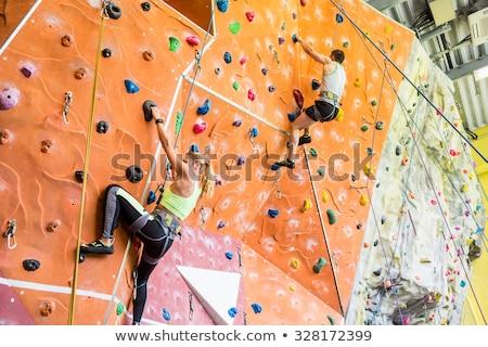 Athletes rock climbing in fitness club Stock photo © wavebreak_media