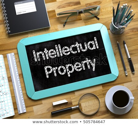 Klein schoolbord intellectuele eigendom 3D tekst eigendom Stockfoto © tashatuvango