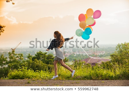 Girl jumping on hill Stock photo © IS2