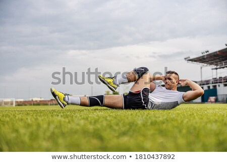 Soccer Player Doing Sit-Ups Stock photo © IS2
