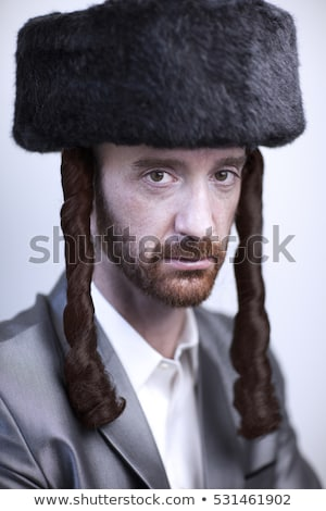 Orthodox jewish man portrait with hat in a black suit. Jerusalem Stock photo © NikoDzhi