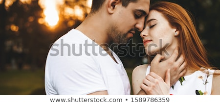 Woman kissing man to neck Stock photo © IS2