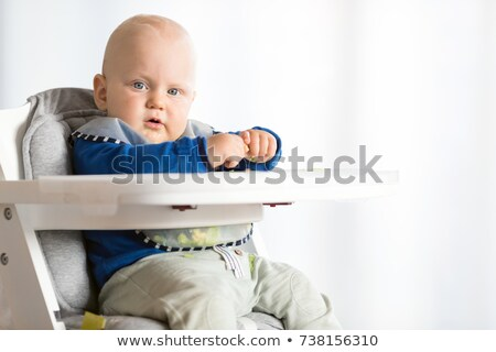 Baby boy serious eating with BLW method, baby led weaning stock photo © blasbike