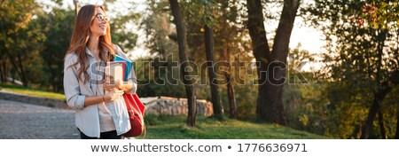 Tam uzunlukta görüntü memnun öğrenci kadın sırt çantası Stok fotoğraf © deandrobot