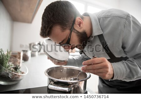 Homme dégustation soupe cuisson Homme loisirs Photo stock © IS2