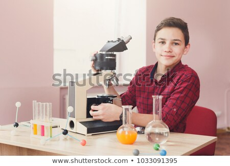 Scolaro microscopio desk ragazzo classe sorridere Foto d'archivio © IS2