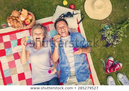 érett pár buborékfújás nő férfi nyár Stock fotó © IS2