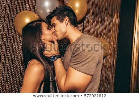 Young couple kissing in a nightclub stock photo © monkey_business