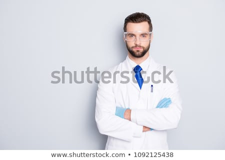 doctor or scientist in lab coat and medical gloves Stock photo © dolgachov
