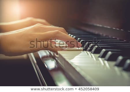 Pianist is playing a song at the church Stock photo © manaemedia