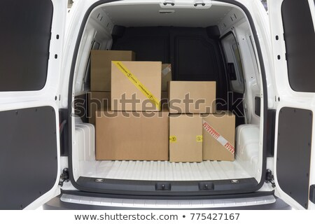 transport services delivery of goods cardboard boxes and van truck stock photo © orensila