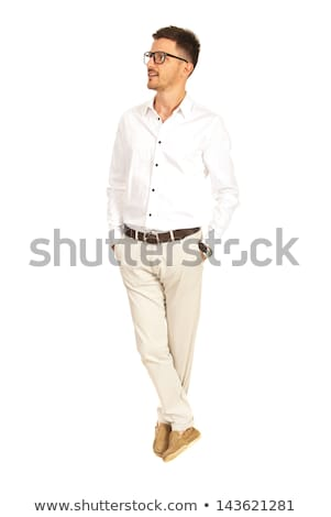 handsome businessman standing with legs crossed looks to side Stock photo © feedough