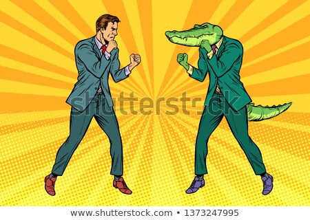Man Boxing fights with crocodile reptiloid Stock photo © studiostoks