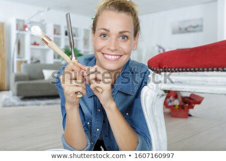 Female painter with drink looking at wall Stock photo © dash
