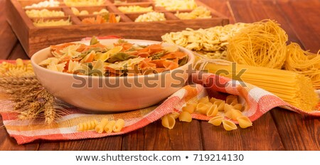 Multicolored spaghetti in wood box Stock photo © dash