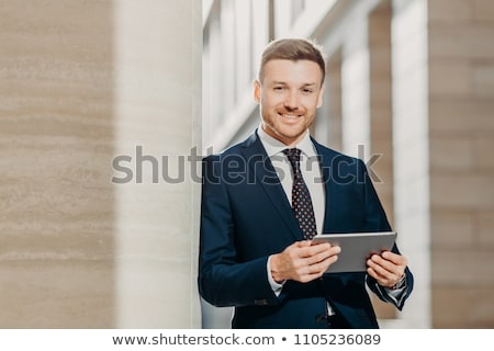 Boldog fiatal férfi menedzser hivatalos dől Stock fotó © deandrobot