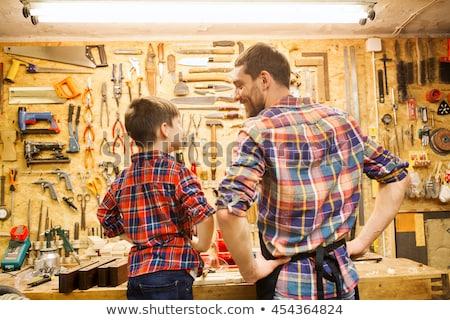 Szczęśliwy syn ojca drewna deska warsztaty rodziny Zdjęcia stock © dolgachov